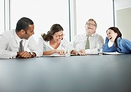 Businesspeople laughing in conference room