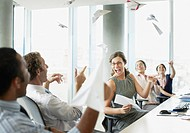 Businesspeople throwing paper airplanes in office (thumbnail)