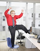 Businessman at desk cheering