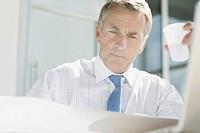Businessman reviewing blueprints