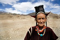 a old woman by the roadside in the mountains