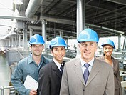 Businesspeople wearing hard_hats in factory