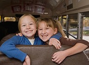Girls hugging on school bus