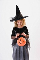 Girl dressed in witch Halloween costume