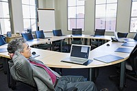 Mature businessman looking at laptop