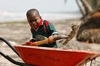 Tasbapauni, Nicaragua, Boy shoveling sand into wheelbarrow