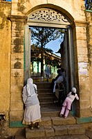 Harar, Ethiopia, People leaning against wall, looking through arch