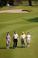 Japanese golfers walking together