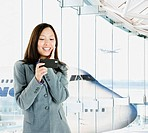 Asian businesswoman text messaging in airport