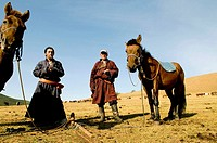 Mongolian nomads enjoy a cigarette break in the vast Mongolian grasslands