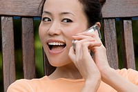 Close_up of a young woman talking on a mobile phone