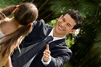 Young man greeting his daughter and smiling (thumbnail)