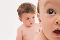 Close_up of two baby boys