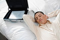 Businessman lying on the bed