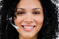 Close_up of a female customer service representative wearing a headset