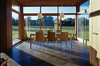 The Lodge, Whithurst Park Interior , dining table chairs and windows. Architect: James Gorst Architects. RIBA Award winner 2002. Traditional 'haybarn'...