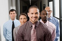 Business executives standing in a corridor (thumbnail)