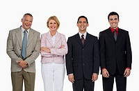 Portrait of a businesswoman standing with three businessmen and smiling