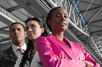 Low angle view of two businesswomen with a businessman at an airport