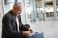 Side profile of a businessman smiling at an airport