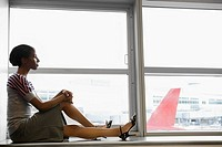 Side profile of a businesswoman waiting in a waiting room at an airport