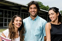 Portrait of three university students smiling