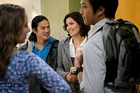 University students talking in a corridor