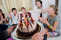 Young woman celebrating birthday with her friends