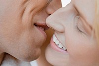 Close_up of a young couple kissing each other