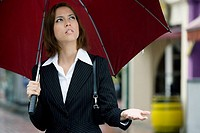Close_up of a businesswoman holding an umbrella
