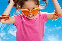 Close_up of a girl wearing sunglasses and smiling