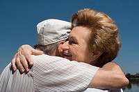 Close_up of a senior couple embracing each other