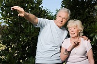 Senior couple standing in a garden