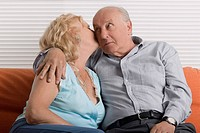 Senior woman kissing a senior man (thumbnail)
