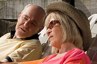 Close_up of a senior couple sitting together