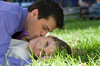 Young couple romancing in a park (thumbnail)