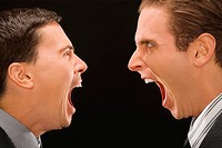 Close_up of two businessmen shouting at each other