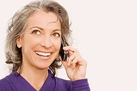 Close-up of a businesswoman talking on a mobile phone and thinking (thumbnail)