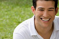 Close_up of a young man smiling