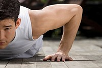Close_up of a young man doing push_ups
