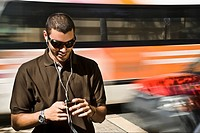 Young man listening to an MP3 player