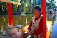 Mature woman traveling on a trajineras, Xochimilco, Mexico