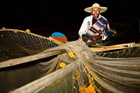 Portrait of a senior man with butterfly fishing net at night