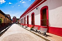 Buildings on both sides of a street, San Cristobal De Las Casas, Chiapas, Mexico