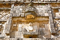 Low angle view of a carved stone wall, Cuadrangulo De los Pajaros, Uxmal, Yucatan, Mexico