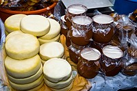 High angle view of stacks of cheese with tofu jars at a market stall, Zacatecas State, Mexico