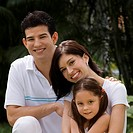 Portrait of a young couple with their daughter smiling (thumbnail)