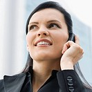 Close_up of a businesswoman talking on a mobile phone and smiling