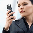 Close_up of a businesswoman using a mobile phone