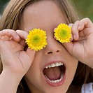 Close-up of a girl holding flowers over her eyes (thumbnail)
